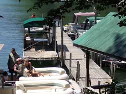 Families prepare to pontoon Lake Glenville from the local marina.